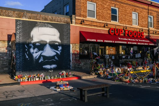 A mural of George Floyd is shown at the intersection of 38th St & Chicago Ave. in Minneapolis, Minnesota. That's the location where Floyd died while in police custody last Memorial Day.