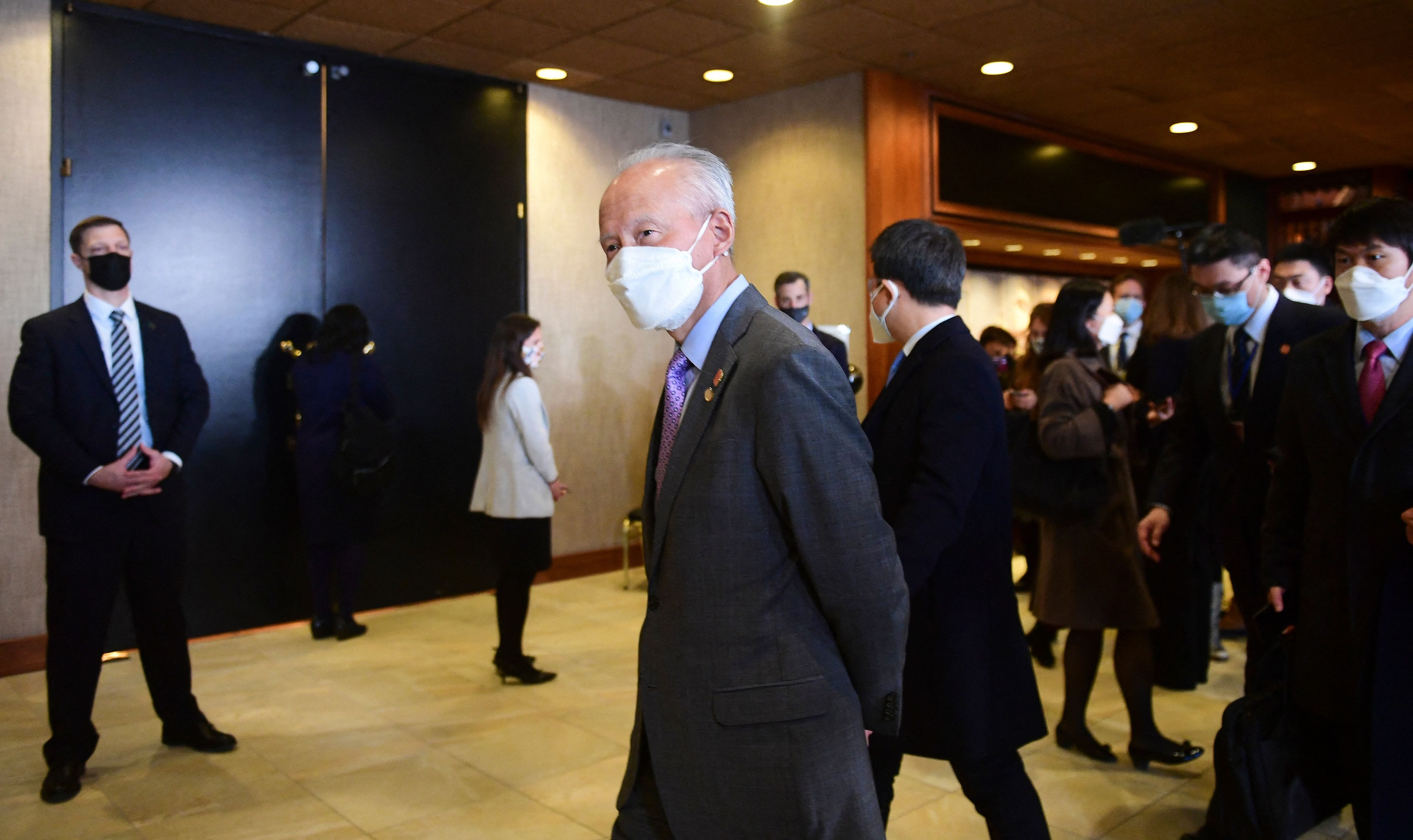 China's Ambassador to the United States, Cui Tiankai, walks past the closed-door morning session of talks between the U.S. and China in Anchorage, Alaska on March 19.
