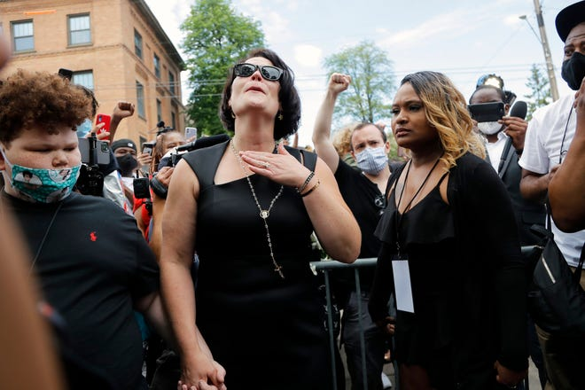 Courteney Ross, center, who had been dating George Floyd, reacts after a memorial service for Floyd at North Central University on Thursday, June 4, 2020, in Minneapolis.