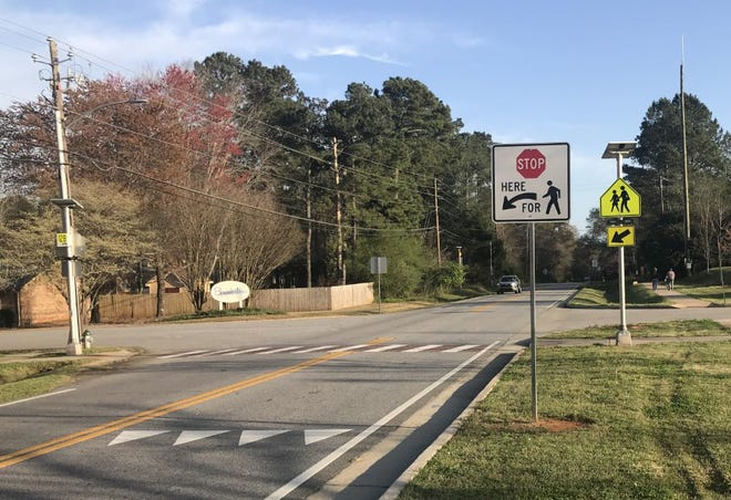 Speed in the school zone at Barnett Shoals Elementary School is monitored by cameras.
