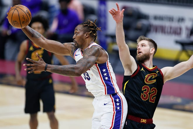 Cavaliers forward Dean Wade, right, battles with Philadelphia 76ers center Dwight Howard during Thursday's  game. [Ron Schwane/Associated Press]