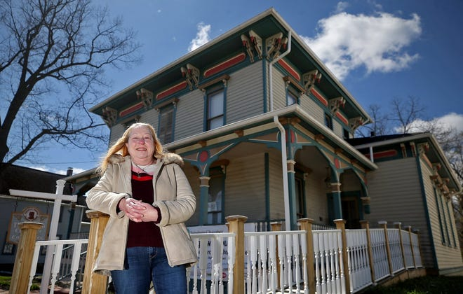 Leslie Roach Bowers stands in front of the house her great-great-great grandfather built. The house, which was built by Moses Roach in 1873, will become the third structure in Twinsburg to be on the National Register of Historic Places.