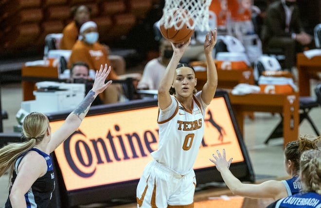 Texas guard Celeste Taylor (0) gets an open look at the basket during a game against Kansas State in Austin on Feb. 21, 2021. Taylor has entered her name into the NCAA's transfer portal.