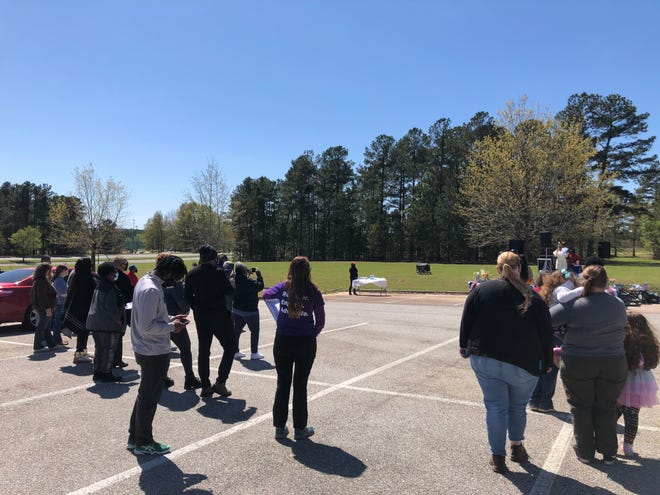 Community members and elected officials gathered at Diamond Lakes to expressed their concerns over the new Georgia voting bill.