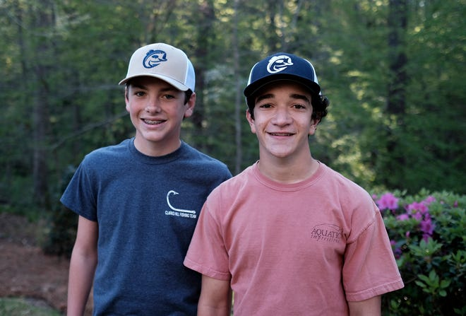 Roper Putnam, left, and his business partner Will Darley show off their new brand of fishing apparel, C.Hill Fishing Co.