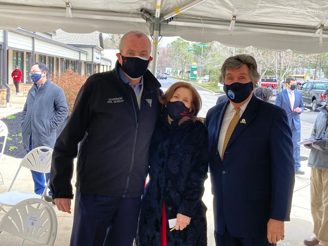 Gov. Phil Murphy, Medford business owner Joanne Damadio and Burlington County Commissioner Dan O'Connell in Medford on Thursday, outside Damadio's boutique store Fond Memories. Gov. Murphy was announcing a micro business grant program.