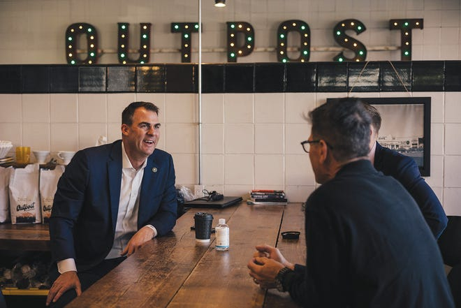 Gov. Kevin Stitt gets coffee at Outpost during an April visit to Bartlesville.