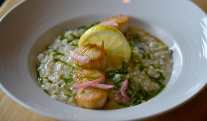 Sauteed local scallops over grilled leek risotto with basil puree is one of the dishes on the menu at the Lanyard Bar & Grill in Harwich Port.