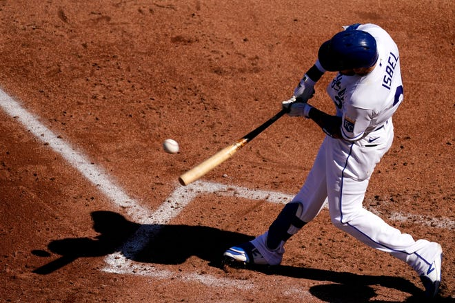 Kansas City Royals' Kyle Isbel hits an RBI single during a game against the Texas Rangers on Thursday in Kansas City.