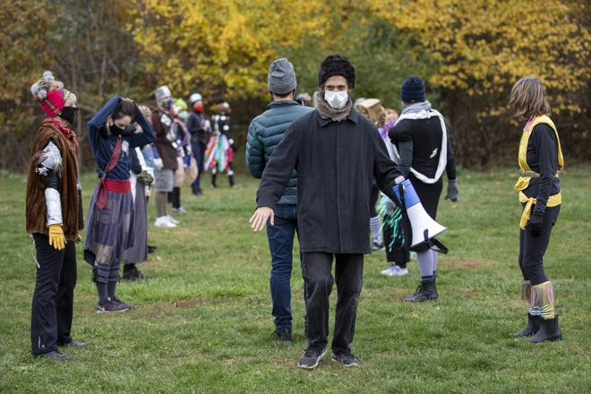 """Russell Lepley gives dancers directing while videographer Doug Carraway films part of the Flux + Flow performance titled """"Spatula"""" at the Park of Roses last fall. The production premieres Saturday."""
