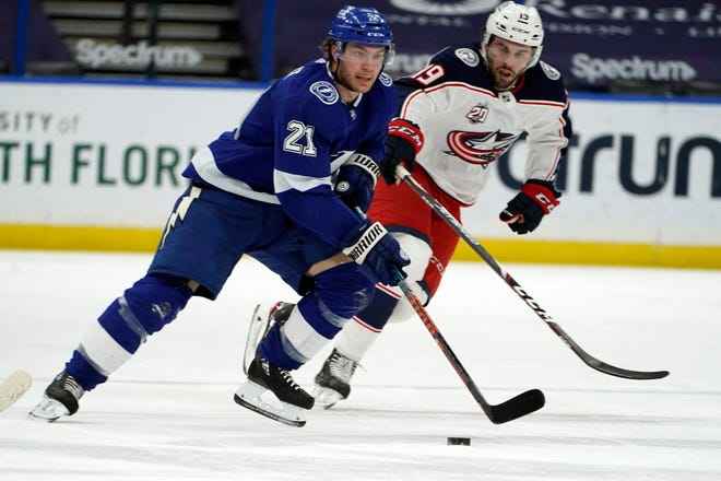 Tampa Bay Lightning center Brayden Point (21) breaks out after getting past Liam Foudy (19) in the second period of the Blue Jackets' 3-2 loss Thursday in Tampa, Fla. Point scored two goals, including the winner late in the third.