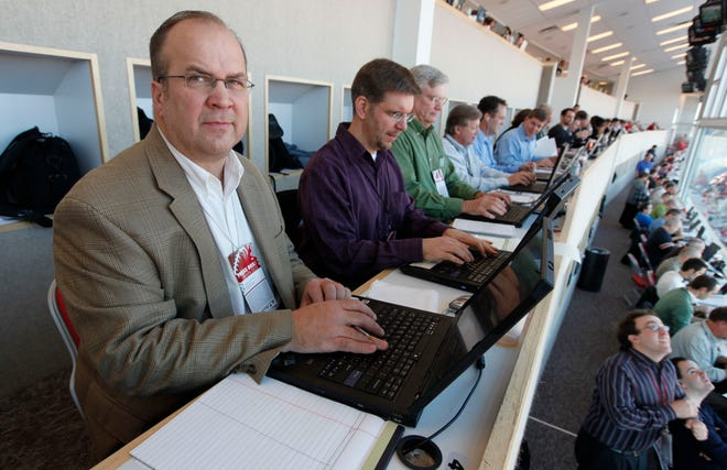 Ray Stein works from the press box at the Ohio Stadium in 2009. Beside him are reporters Ken Gordon, Tim May, sports columnist Bob Hunter, reporter Rob Oller and reporter Bill Rabinowitz.
