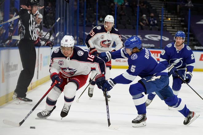 Blue Jackets center Max Domi skates past Lightning defenseman Andreas Borgman on Thursday. Domi had two assists in the Blue Jackets' 3-2 loss.