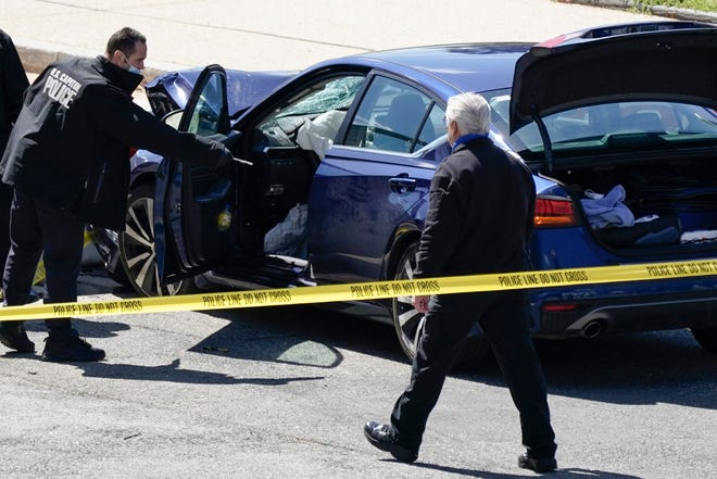 Officers of the U.S. Capitol Police work at the scene where a man drove a car into a barricade at the Capitol complex April 2. One officer was killed and other injured. The driver was fatally shot by officers.