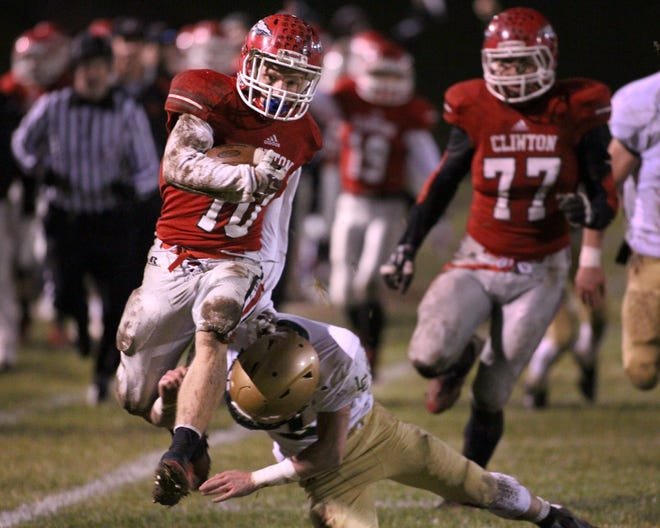 Clinton's Mathew Sexton rushes with the ball during a playoff game in the 2015 season.