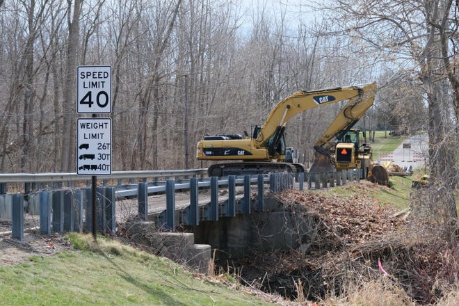 Work to replace the Country Club Road bridge over Wolf Creek in Adrian Township began Thursday.