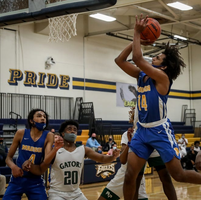 Madison's Rovahn Roberts puts up a shot late in the fourth quarter of Thursday's Division 3 regional final against Ypsilanti Arbor Prep at Erie Mason.