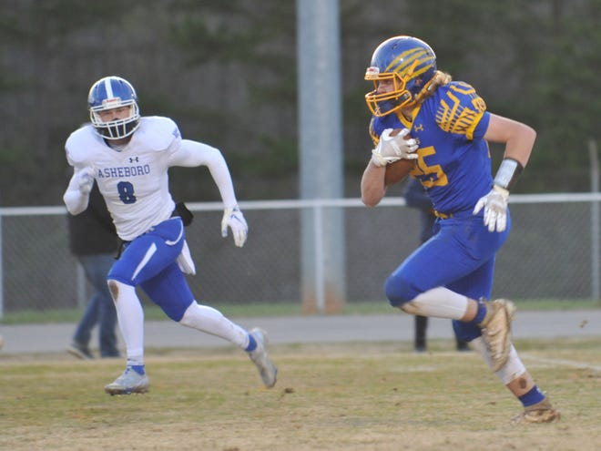 Southwestern Randolph's Eli Gravely heads for the end zone on a 38-yard touchdown reception as Asheboro's Logan Richardson gives chase. [Mike Duprez/Courier-Tribune]