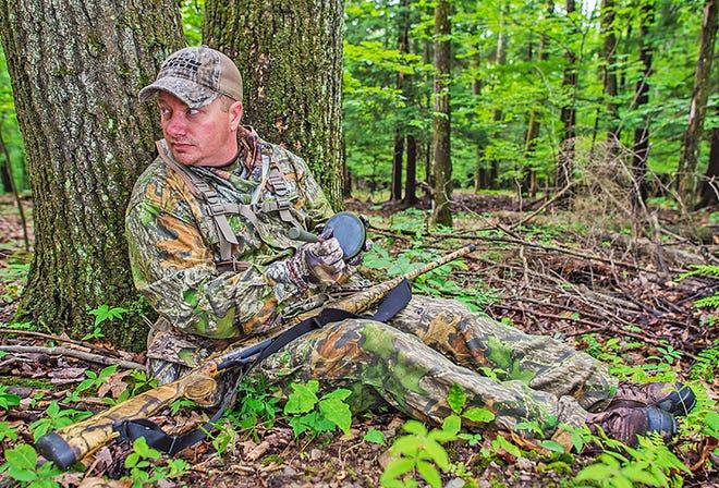 PGC marketing director and champion turkey caller Matt Morrett calls in a turkey during a foray into Penn's Woods.
