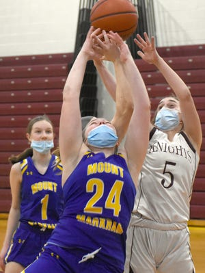 Frankfort-Schuyler Maroon Knight Brooke Lawson (5) grabs a rebound behind Mt. Markham Mustang Abbie Ainslie (24) during the first half of Thursday's game.