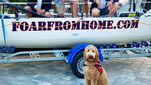 The Foar from Home rowing team — Cameron Hansen (from left) Billy Cimino, Paul Lore and Hupp Huppmann — pose with mascot Chewy. The dog is training to be a veterans service dog at K9s for Warriors, one of the charity beneficiaries of the team's participation in a 3,000-mile ocean row.
