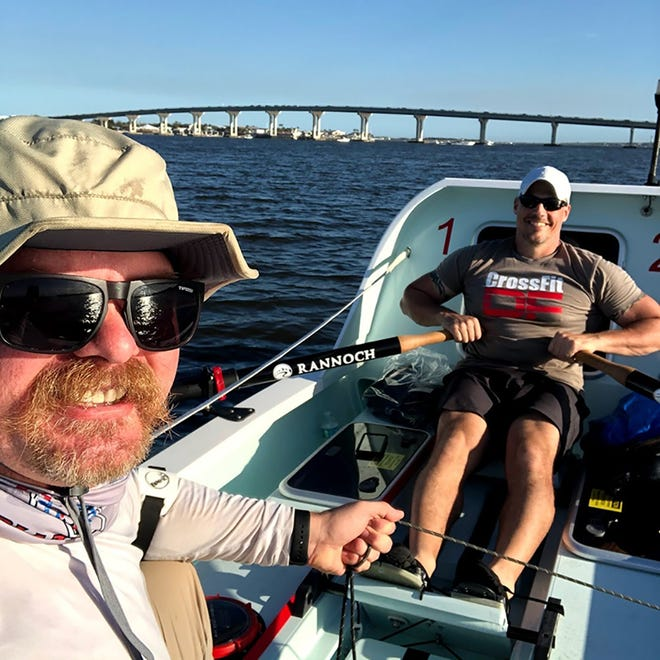Ben Odom (left) and Mat Steinlin train in the specially designed rowboat that will carry them across the Atlantic Ocean in a charity rowing challenge.