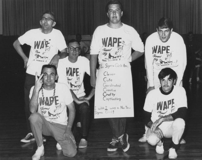 """WAPE's disc jockeys at a promotional charity basketball game in 1968. In the back row, from left to right: Dale Kirby, Ron Wayne, Jim Shirah and Alan Sands. In the front row are chief engineer Ike Lee (left) and """"Honest"""" John Ferree."""