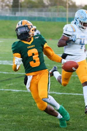 Crest wideout Caleb Borders scurries into the end zone after scoring a touchdown during Thursday's game against Burns.