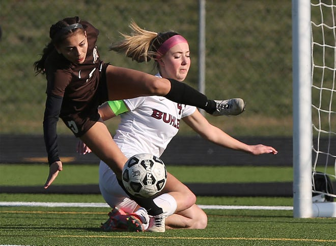 Garden City's Jocelyn Sosa (5) and Buhler's Alexis Hutton (43) collide as they go for the ball  during their Goddard Invitational Soccer Tournament game Wednesday afternoon at Goddard High School. Buhler defeated Garden City 1-0. GCHS finished the tournament in fourth place.