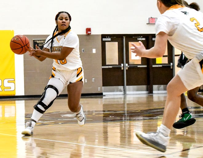 Garden City Community College's Aerihna Afoa passes the ball off to a teammate while running the Broncbusters' offense March 24 against Seward County at Perryman Athletic Complex.