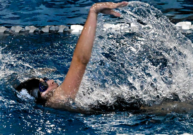 Garden City High School's Lana Rodriguez makes a stroke while competing in the backstroke portion of the 200-yard IM Thursday during a home quadrangular at the Garden City Family YMCA. The event was one of two individual events that Rodriguez won.
