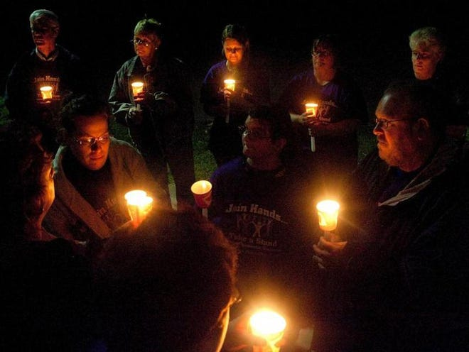 FILE: Members of the Galesburg community gather at Lake Storey Pavilion to take part in Safe Harbor's annual Take Back The Night rally and candlelight vigil.