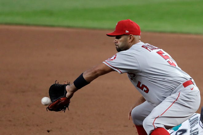 Los Angeles Angels first baseman Albert Pujols reaches for a ball in a game against the Seattle Mariners on Wednesday, Aug. 5, 2020, in Seattle.