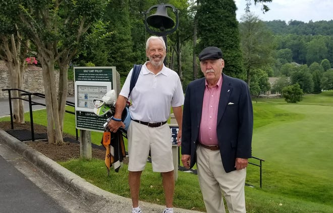 WHKP President Art Cooley, right, poses with North Carolina men's basketball coach Roy Williams last summer at Kenmure Country Club.