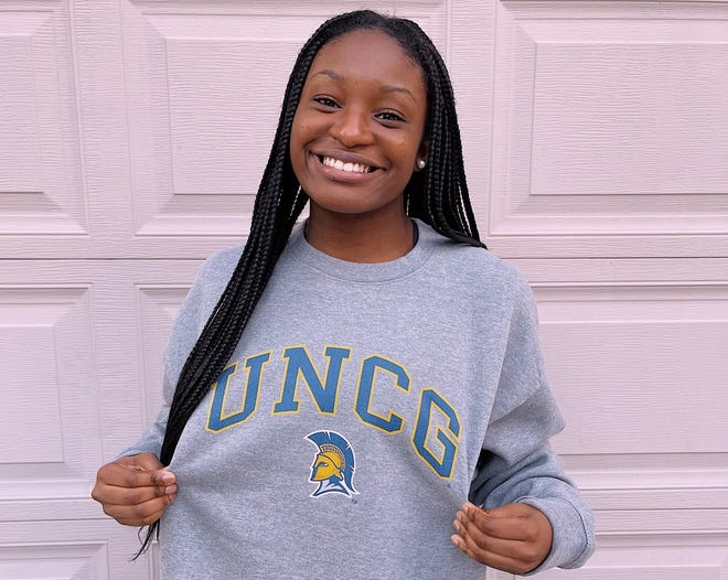 West Henderson High volleyball standout Daija Jackson poses in her UNC Greensboro sweatshirt after committing to the university recently.