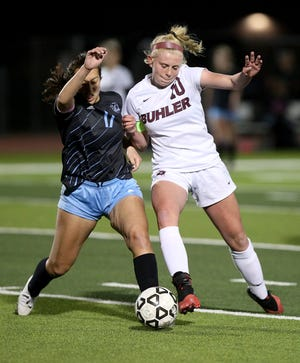 Buhler's Aubrey Tanksley (10) gets the ball past Eisenhower's Lexi Jack (17) during their tournament championship game Thursday evening in Goddard. Buhler lost to Eisenhower 8-0.