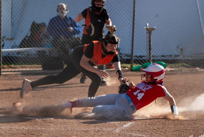 Inman's Emma Brown (2) reaches to tag out Trinity's Reiley Wells (14) at home plate in Inman Thursday afternoon.