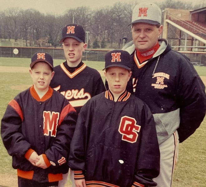 Former Massillon baseball coach Tim Ridgley, back right, with sons, clockwise from back left, Spike, Trent and Ryan during the mid-1990s.