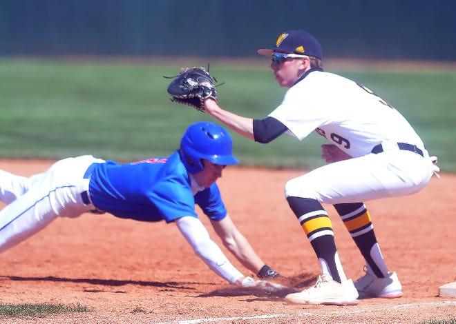 Newton senior Trev Golubski takes a pickoff throw as Dodge City junior Tucker Smith gets back to base.