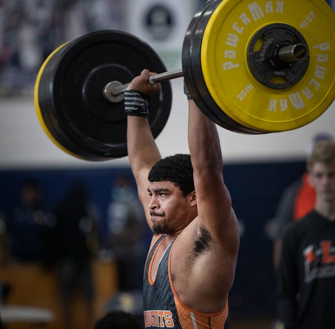 Lakeland's Carlisle Johnson makes a lift in the 199-pound class during the Class 3A, District 10 weightlifting meet. From winning the district title he went on to become one of two weighlifters from Polk County to win a state title. Ridge Community's Gregory Hendrix won the 183-pound weight class.