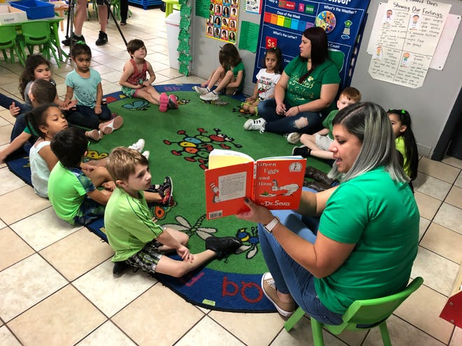 Pre-kindergarten students at The Learning Station in North Lakeland listen to Green Eggs and Hamm by Dr. Seuss in March 2020 in this file photograph.