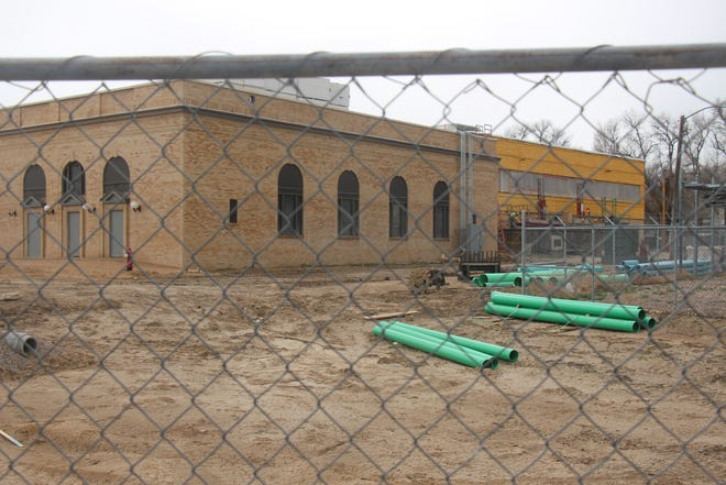 Fencing surrounds the Manzanola School where construction is taking place to make a new building and renovations to the existing one. The first phase of the project ends in August.