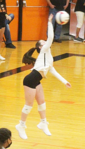 La Junta High School's Reece Addington serves the ball in Thursday's match against St. Mary's at tiger Gym. The Tigers lost in three sets.
