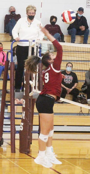 Swink High School's Edit Morales hits the ball over the net in Friday's match against Las Animas at the Lions Den. The Lions defeated the Trojans in three sets.