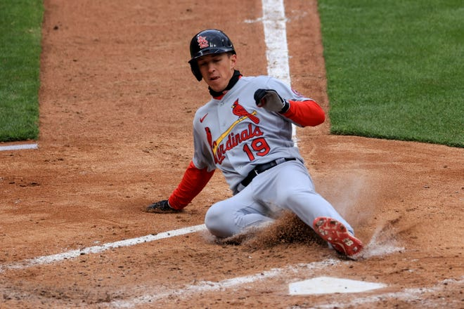 St. Louis Cardinals' Tommy Edman scores a run on a wild pitch by Cincinnati Reds' Luis Castillo during the fourth inning of the baseball game in Cincinnati, Thursday, April 1, 2021.