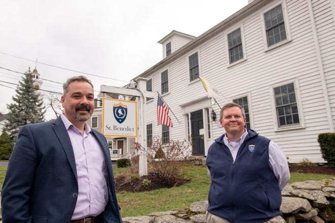 St. Benedict Classical Academy board President Daniel Bachiochi, left, and Headmaster Jay Boren, in front of the private Catholic school on Pleasant Street South in Natick on Thursday.