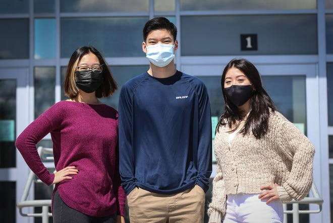 Framingham High students, from left, Emily Gee, Gared Wong and Sylvia Rodrigues, are pushing for school leaders to include Asian American history into the curriculum at Framingham Public Schools, in light of a nationwide rise in anti-Asian hate crimes.