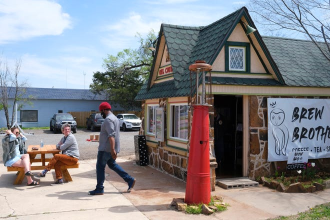 Vick carries drinks to customers outside of Brew Brother in Oklahoma City.