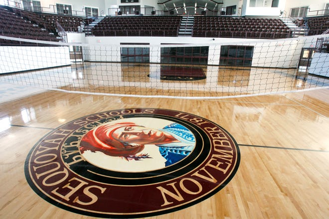 """The logo of Sequoyah High School, a school in Tahlequah operated by the Cherokee Nation, depicts Sequoyah, a Cherokee tribal member who developed the tribe's syllabary. The school's mascot, also the """"Indians,"""" is represented by a spear with feathers on it."""