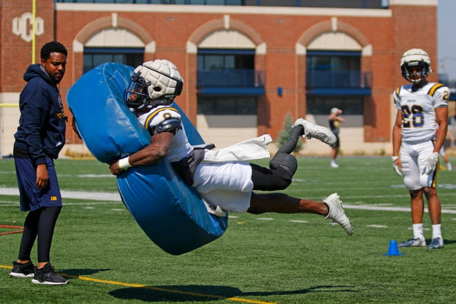 UCO football player Derek Loccident takes part in a drill during practice at Wantland Stadium in Edmond on Thursday. Loccident lost his foot in a train accident three years ago.